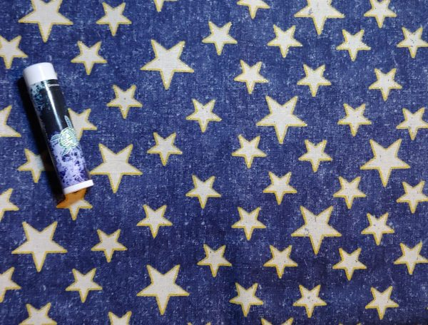 Blue background with white stars outlined in gold