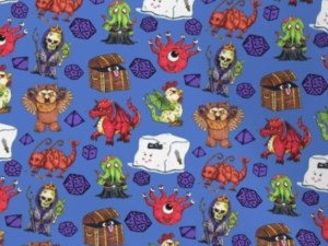 fabric with monsters from Dungeons and Dragons on a blue background