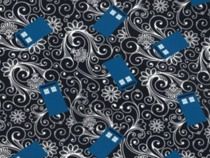 fabric with TARDIS police box on black background with white swirls