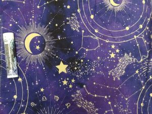 purple with gold constellations and zodiac