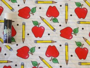 apples and pencils on a white background