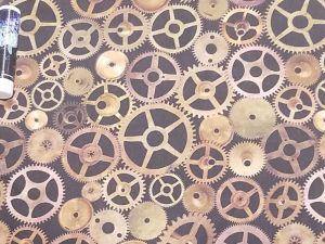 metallic cogs and gears on a brown background