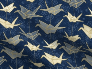 origami cranes on a blue background with traditional Japanese motifs