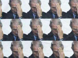 a repeating image of Dr. Fauci face-palming