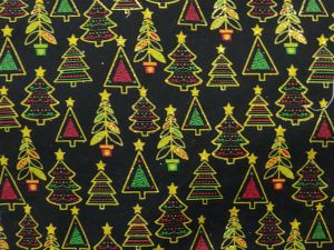 red and green Christmas trees outlined in gold glitter on a black background