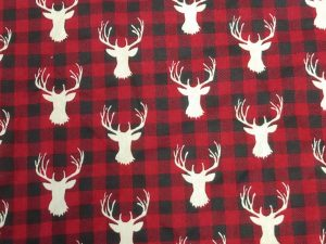 white stag heads on red and black flannel look print
