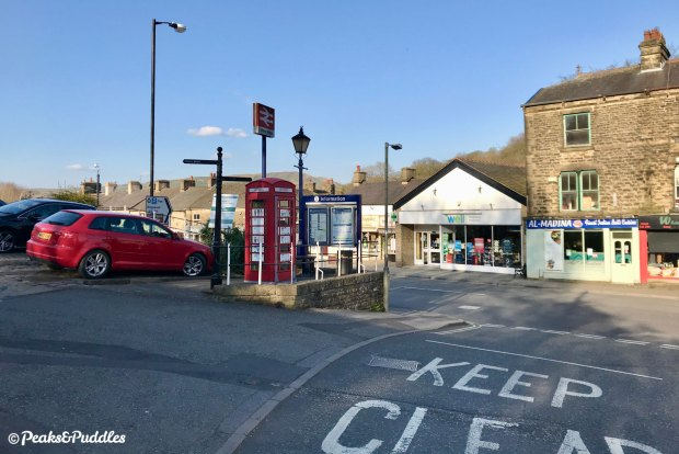 The centre of Whaley Bridge with shops and local businesses.