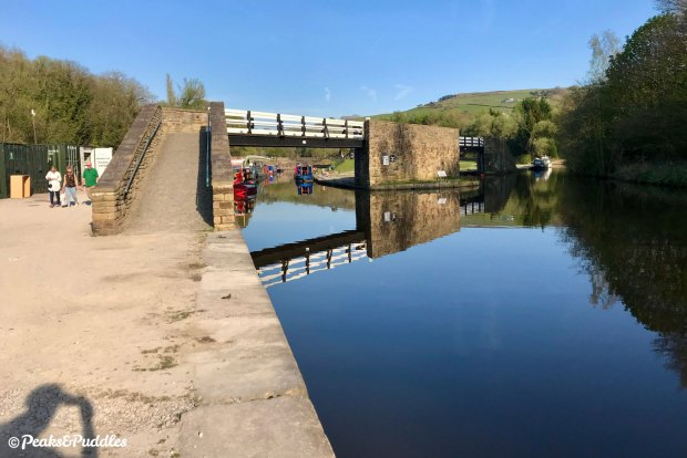 Bugsworth Basin is now a beautiful expanse of water following painstaking restoration. The crossover bridge between the wharfs is a recreation of the original.