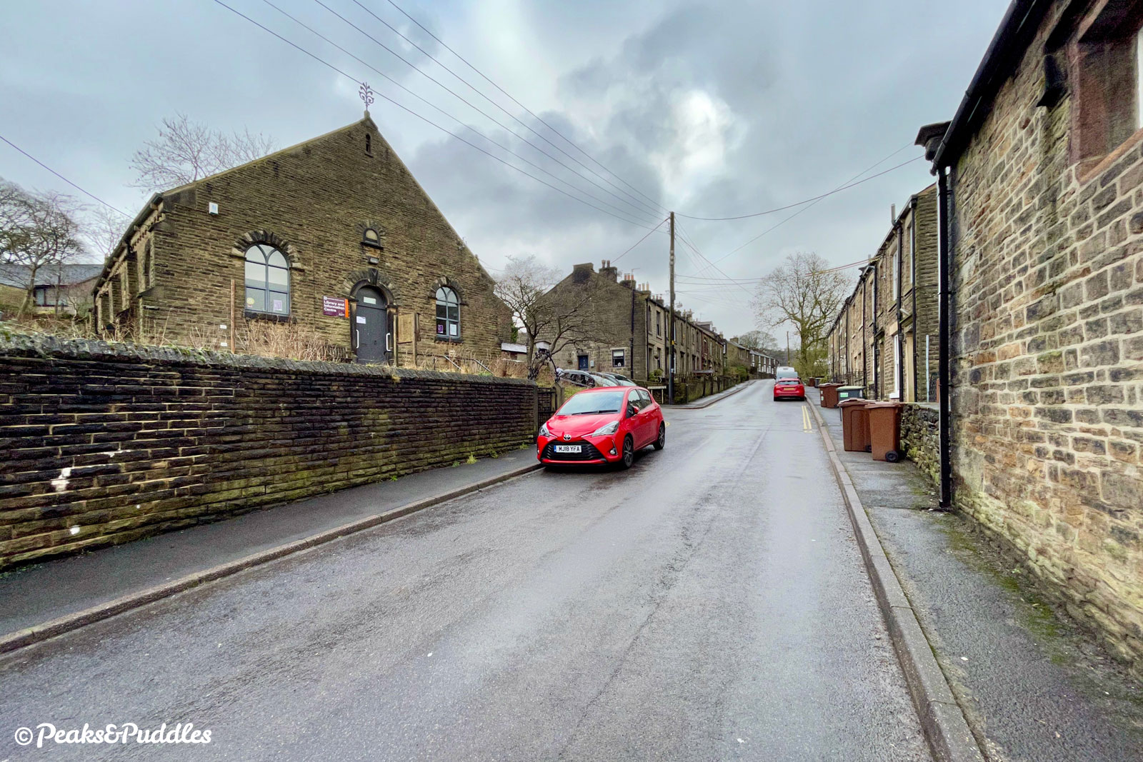 Continuing up Kinder Road, past terraced cottages and the village library.