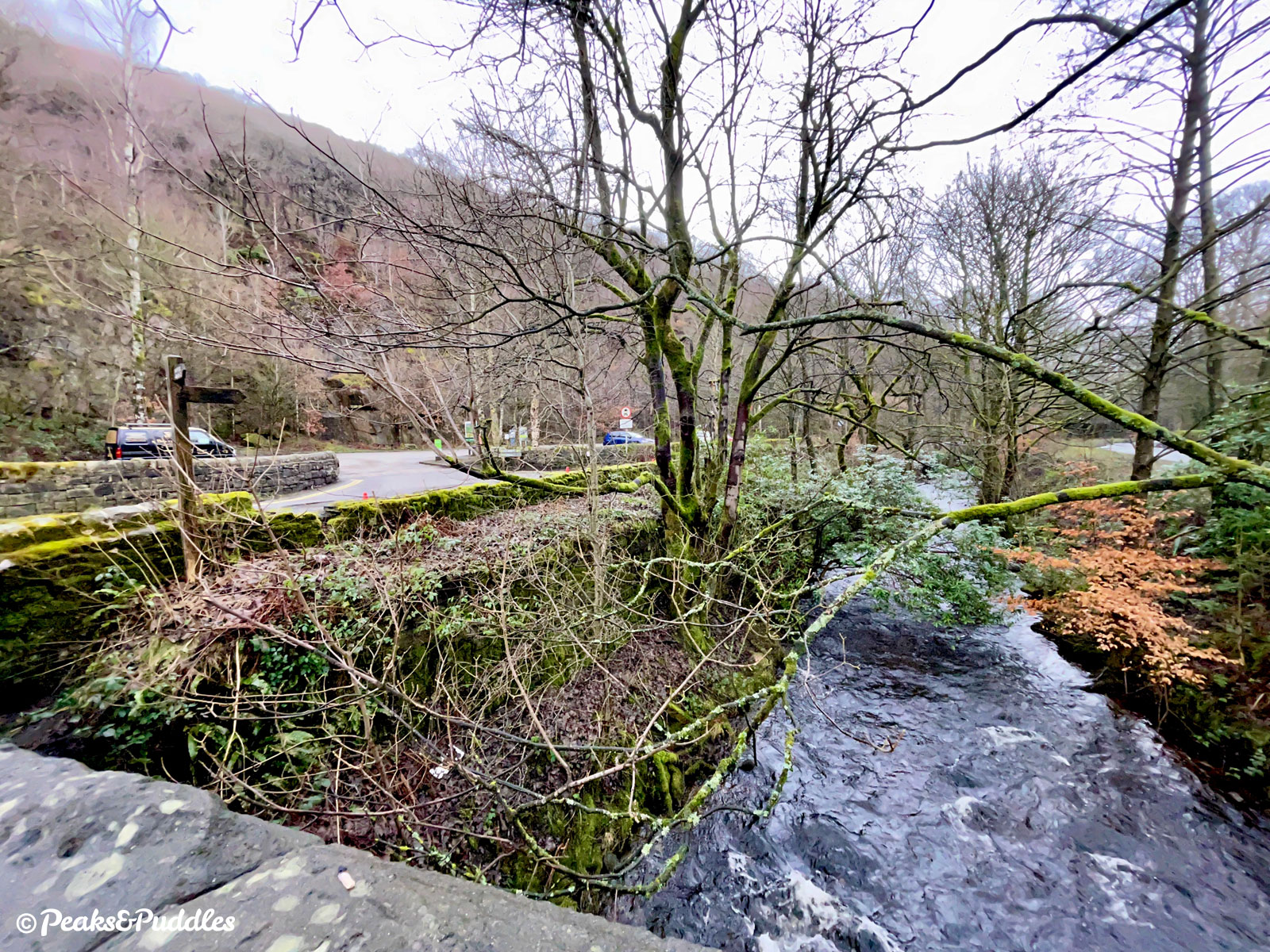 Looking to Bowden Bridge Quarry from the first bridge over the raging River Sett on a dull winter day.
