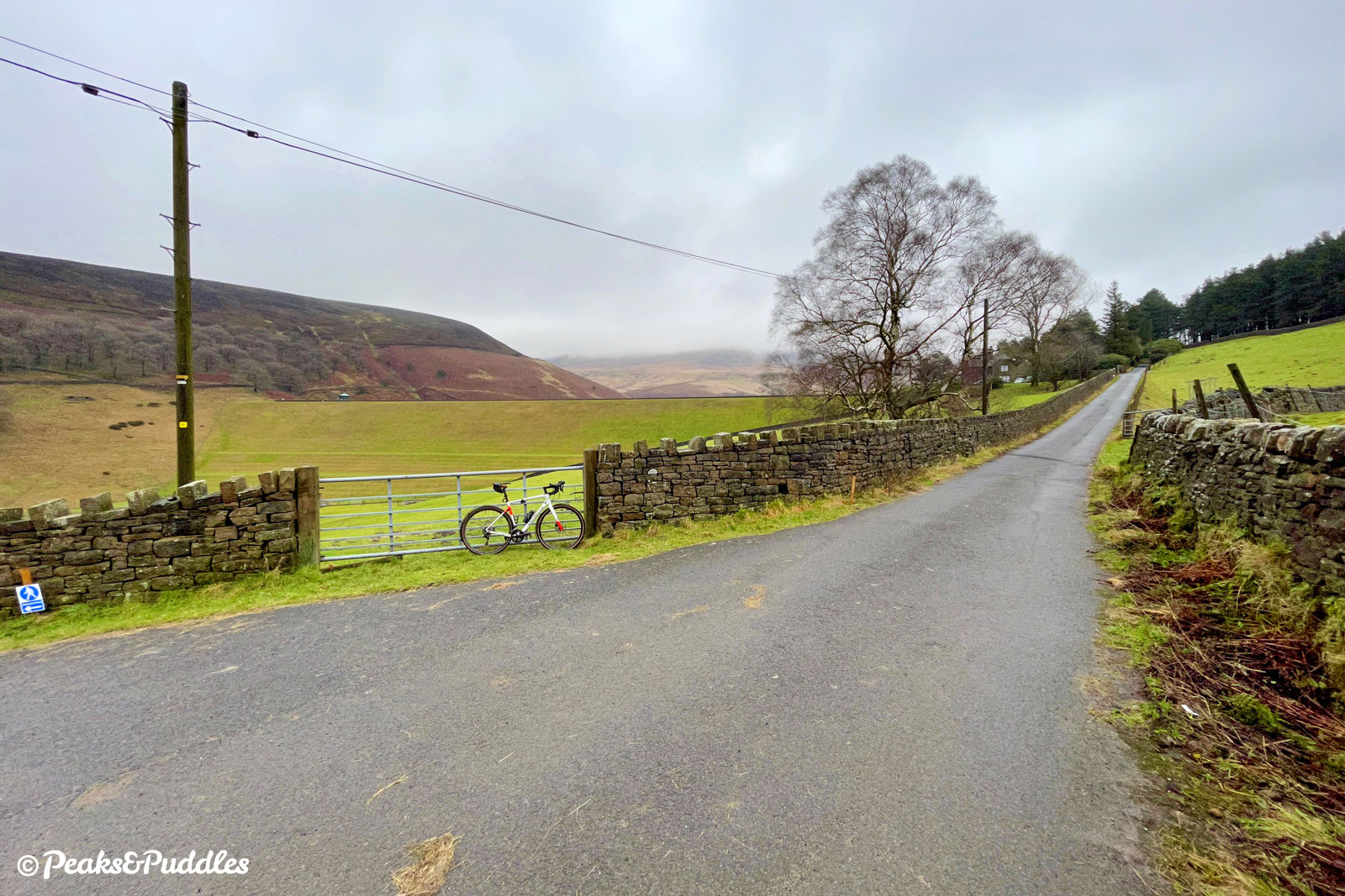 The lane ahead now truly is private, but at this crossroads of sorts bridleways join from either side for more challenging off-road adventures.
