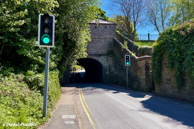 Immediately after turning left off Middlewood Way onto Grimshaw Lane, there's a sharp climb beyond this odd traffic light-controlled canal bridge.