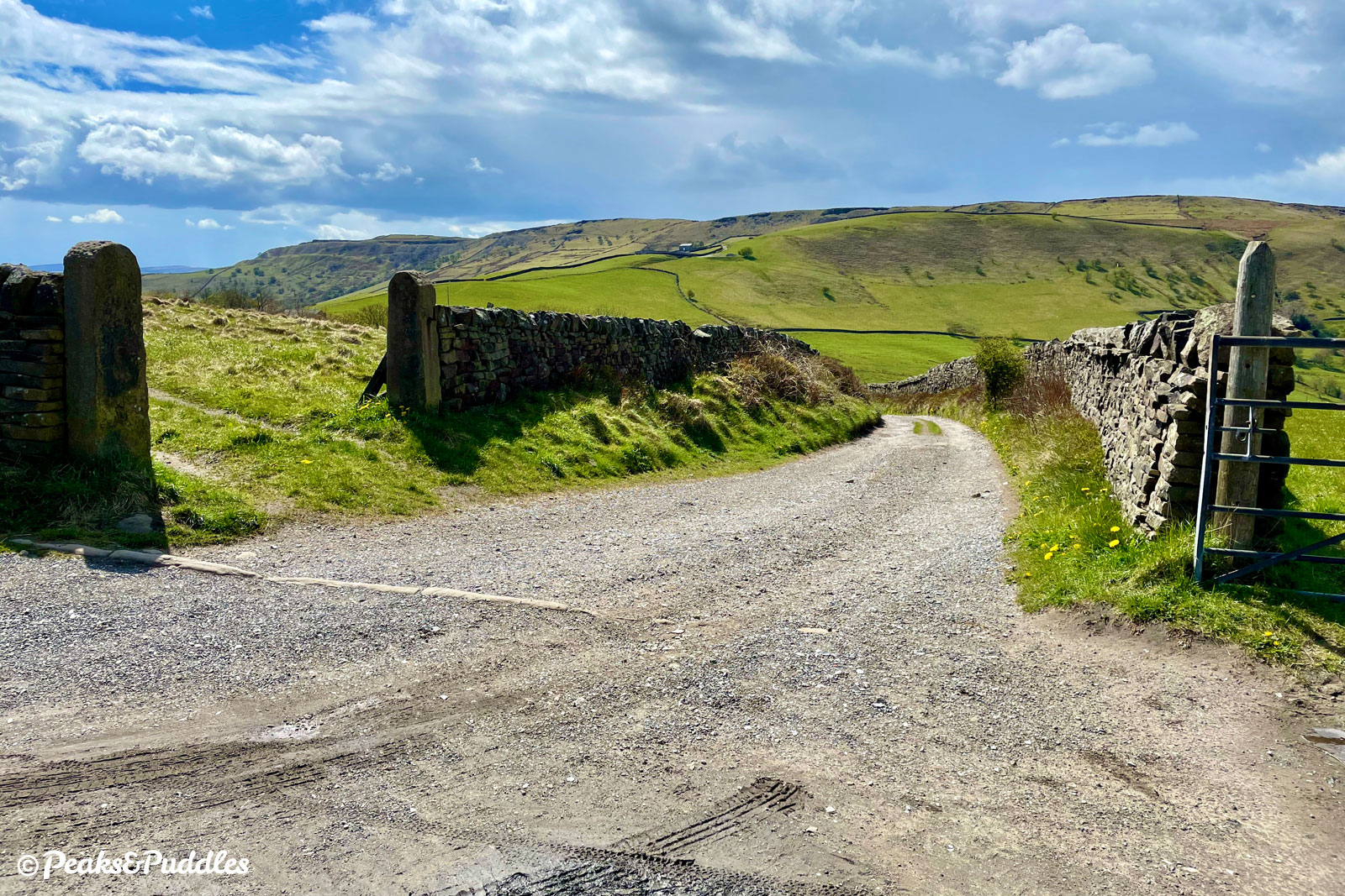 (Bridleway option) At the bridleway crossroads, turn right onto a wide track leading beautifully towards the huge mass of Chinley Churn.