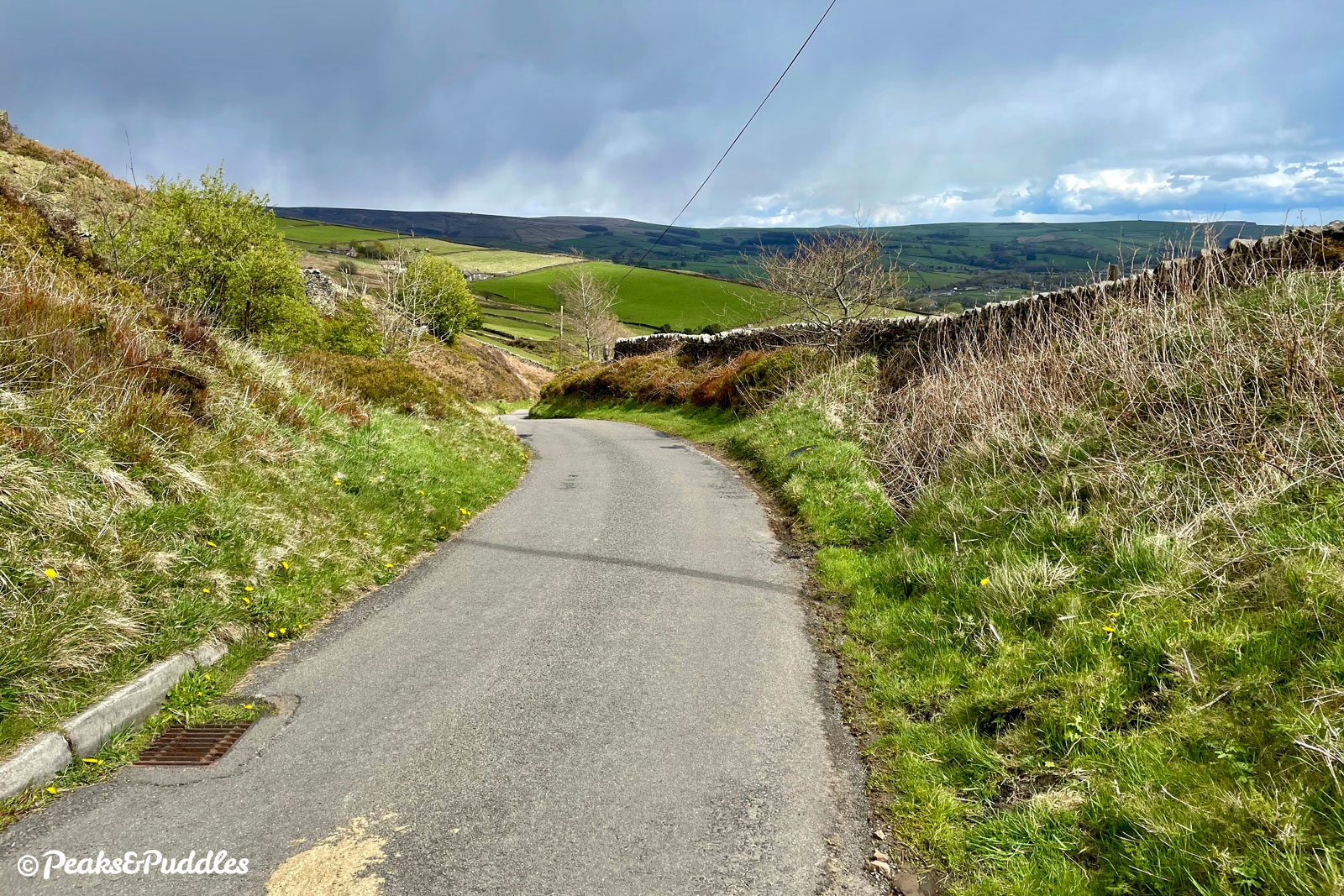 Looking back down Over Hill Road, the distant hills belong to Bagshaw and Peaslows.