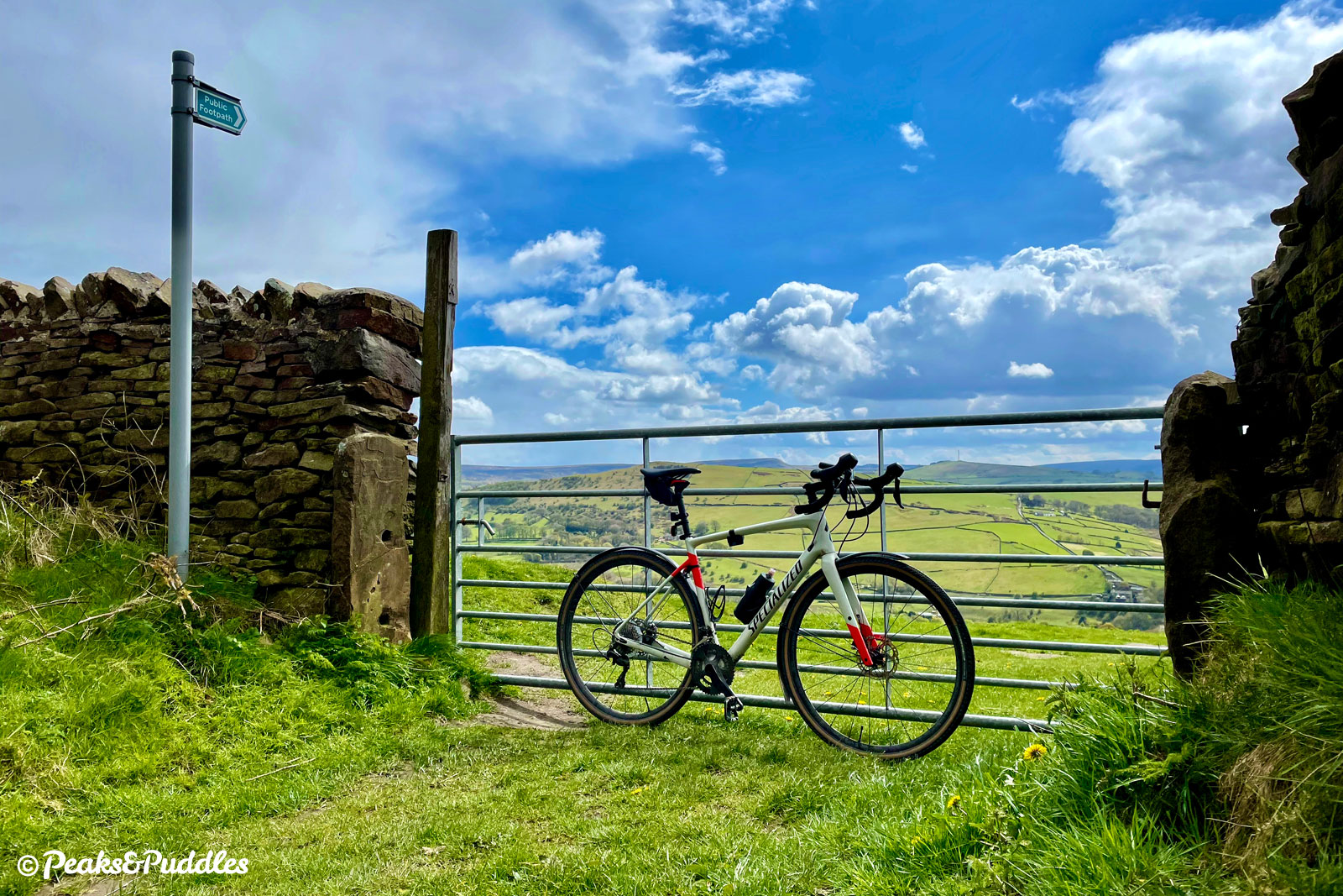 Savouring the view over the Black Brook valley of Eccles Pike at a break in the tall stone walls and sharp climb of Over Hill Road.