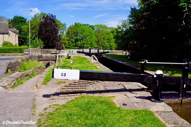 """The """"Posset Bridge"""" has arches for the horse tunnel, the main canal below Lock 13 and a blocked-up third arch which once served a branch to Oldknow's Lime Kilns."""