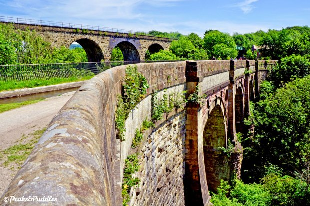 Despite its hefty stone structure, the 200 year old Marple Aqueduct manages to have a wonderful touch of graceful whimsy in the way it crosses the River Goyt.