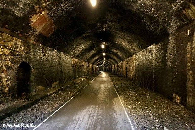 Riding a bike through the Monsal Trail tunnels is a truly unforgettable experience, one of the cycling highlights of Great Britain, let alone the Peak District.