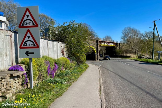 Escape the A624 Hayfield Road by taking a left under the first arched railway bridge into Wash.