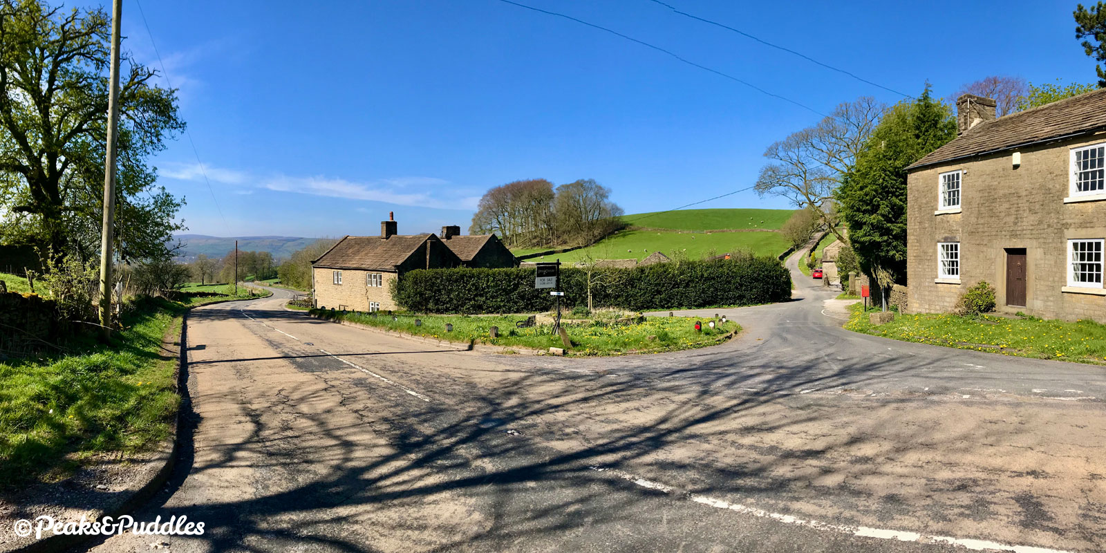 Looking back over Sheffield Road, which climbs up from Chapel-en-le-Frith, to the cottages at Slackhall.