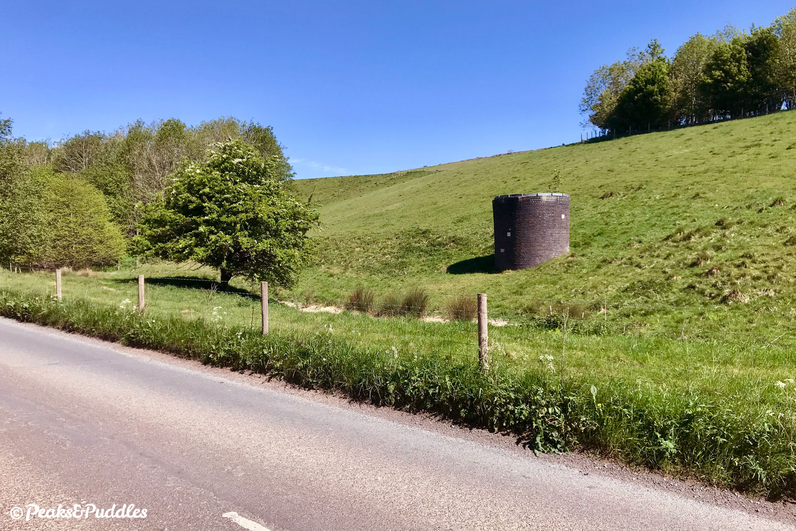 Beside Dale Road between Peak Dale and Dove Holes, the first ventilation shafts of the Dove Holes Tunnel can be spotted. These are eerily similar to those of the Disley Tunnel, on the same line.