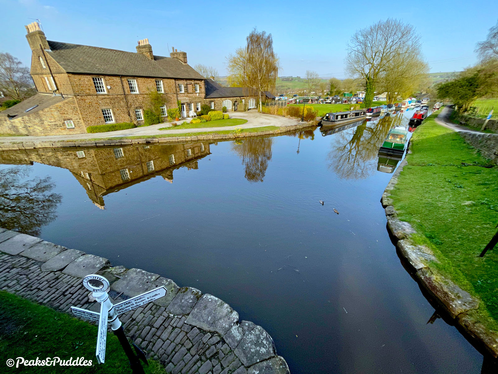 Looking to Top Lock House and the start of the Upper Peak Forest Canal from Marple Junction, atop the first bridge of the Macclesfield Canal.