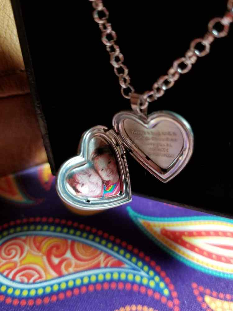 Locket with etched colored picture