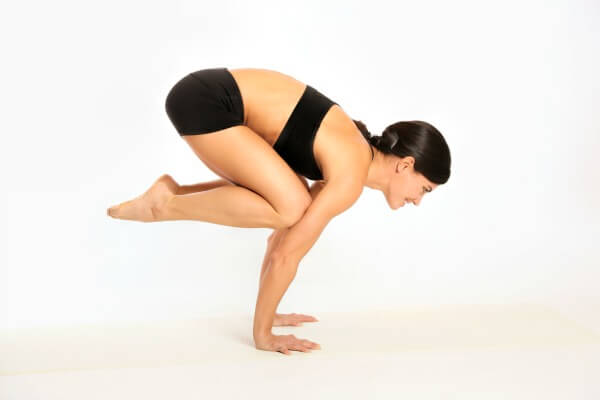 Tips for getting into Crow Pose and variations of the arm balance