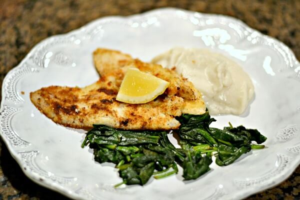 Whole30 compliant coconut flounder with mashed cauliflower and sauteed spinach.
