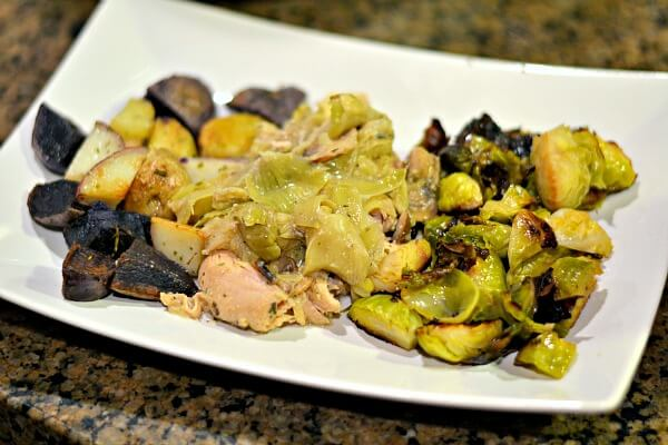 Whole30 compliant lemon, artichoke and mushroom chicken with roasted potatoes and brussels sprouts.
