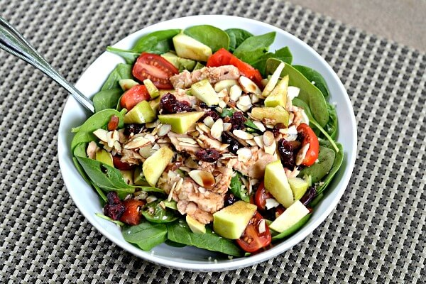 Salad with spinach, apples, canned salmon, tomatoes, cranberries, almonds, avocado and balsamic/olive oil.