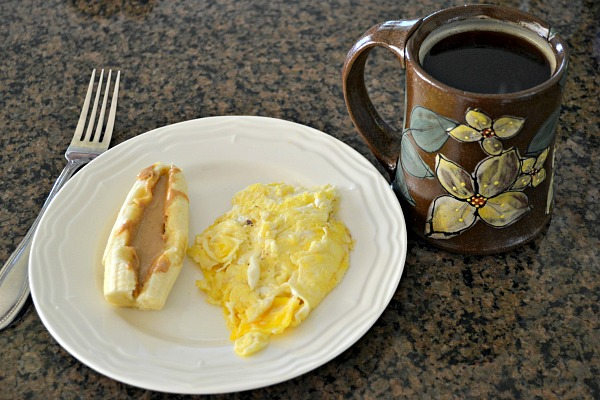 Two eggs, half of a banana with cashew butter and second cup of coffee