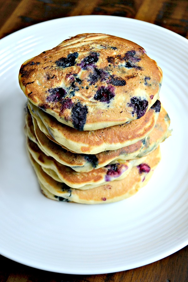 These Dairy-Free Blueberry Buttermilk Pancakes are bursting with fresh blueberries and taste just like the real thing but are made with coconut milk and apple cider vinegar.