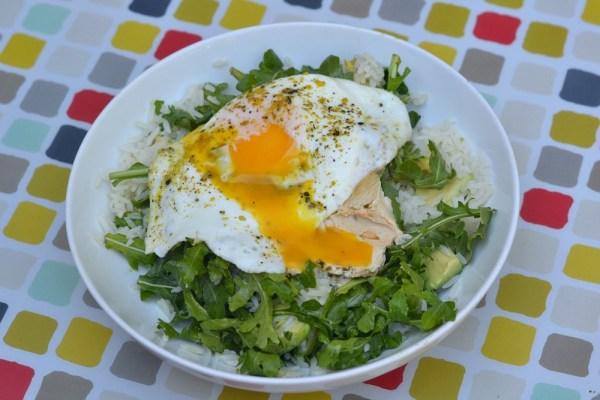 Jasmine rice cooked in coconut oil and mixed with avocado and arugula. Topped with a scoop of hummus and a runny egg.