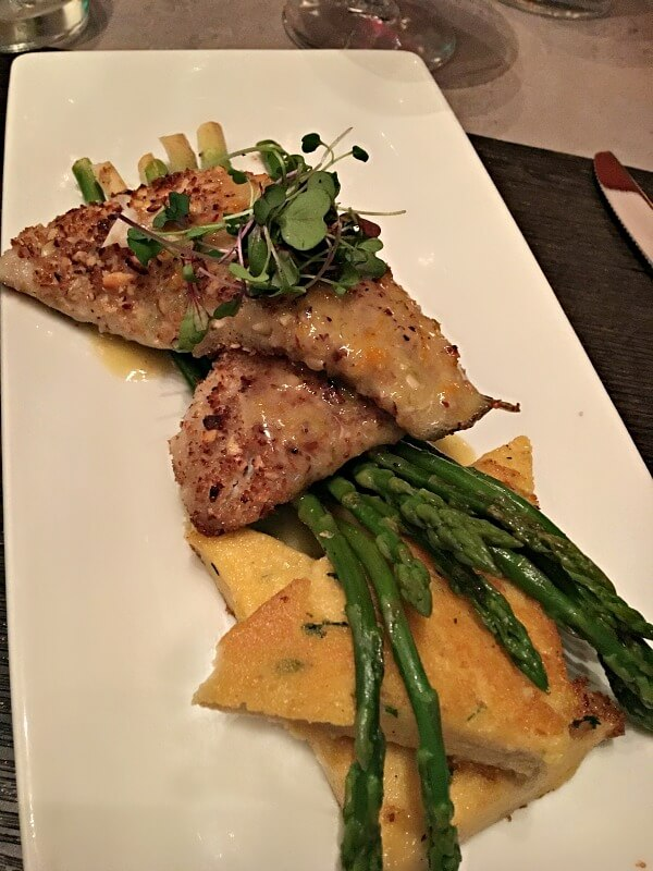 almond crusted speckled trout over polenta cakes with asparagus and a citrus beurre blanc