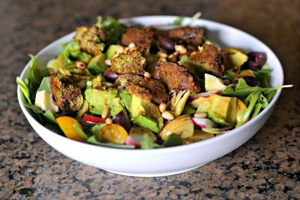 Salad with spinach, bibb lettuce, sun drop cherry tomatoes, radishes, kalamata olives, artichoke hearts, avocado, pine nuts and falafel.