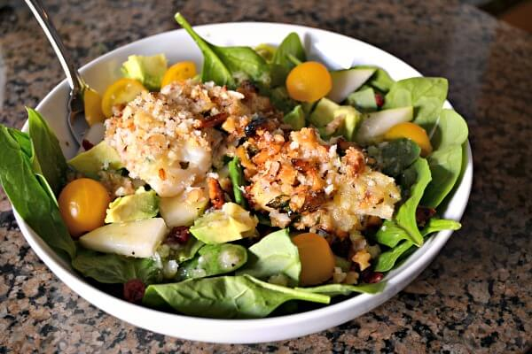 Salad topped with fish