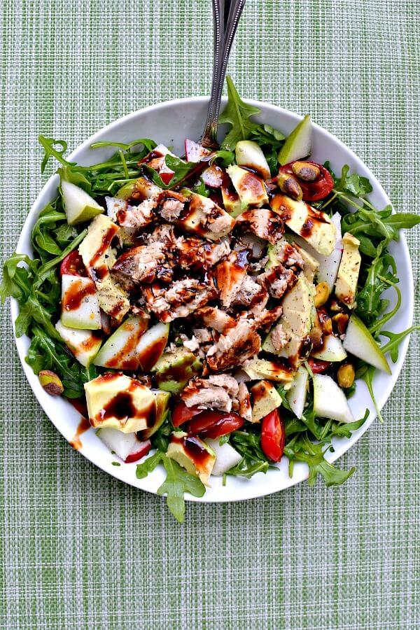 Arugula, avocado, pears, radishes, canned salmon, tomatoes, pistachios, olive oil, lemon juice, balsamic, sea salt.