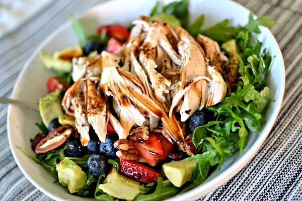 Arugula, avocado, blueberries, strawberries, toasted pecans and shredded chicken.