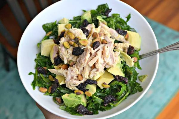 Baby kale, avocado, dried cherries and pistachios topped with shredded chicken that I mixed with lemon cayenne hummus.