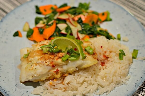 Tempura fried cod over jasmine rice with a Thai-style vegetable salad.