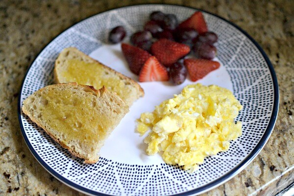 Scrambled eggs, sourdough toast with salted Kerrygold butter and fruit.