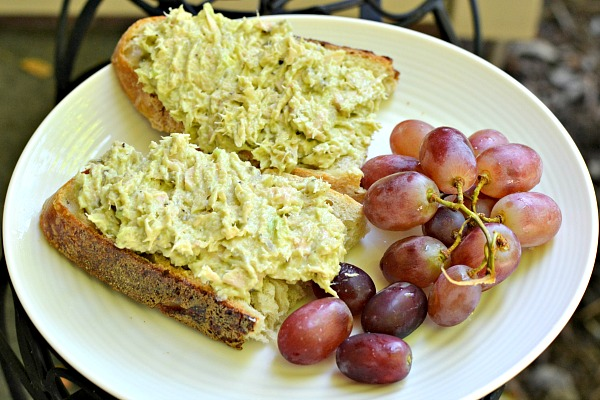Tuna salad made with mayo, half a mashed avocado, relish, lemon juice and lemon pepper on sourdough with grapes