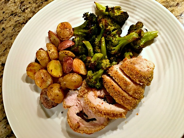 stuffed chicken breats with roasted potatoes and broccoli