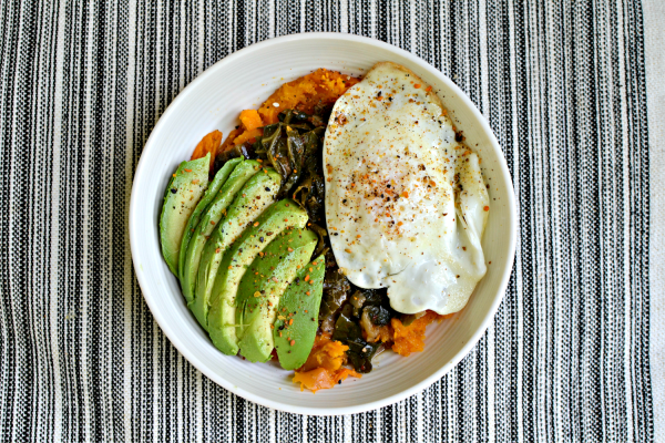 Mashed sweet potatoes topped with braised collards, a perfect egg, avocado and Be Runa Garlic Cayenne Seed Salt