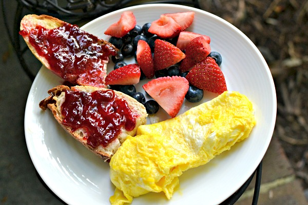 scrambled eggs with fruit and toast
