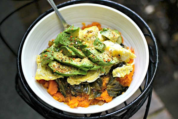 mashed sweet potatoes, collards, scrambled eggs and avocado