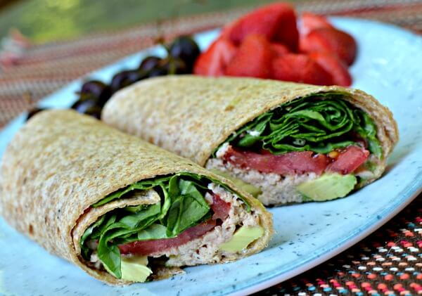 wrap with salmon salad, avocado, tomato and spinach