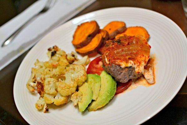 Bunless burgers with kimchi and sriracha lime aioli and served it over sliced tomatoes. Avocado, roasted cauliflower and roasted sweet potatoes on the side.