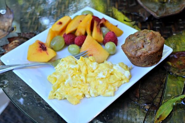 scrambled eggs, fruit and muffin